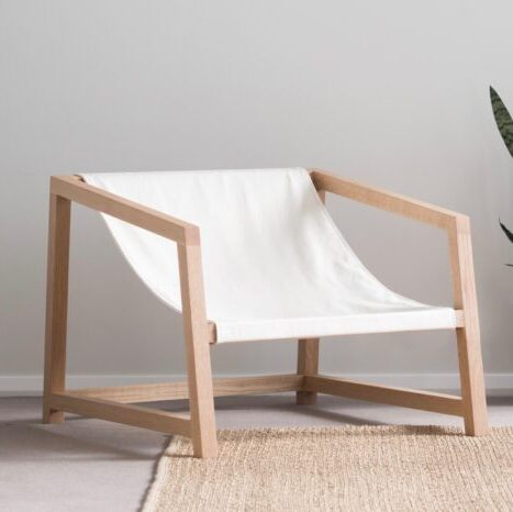 white-wooden-chair-plant